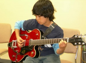 child with Elect guitar